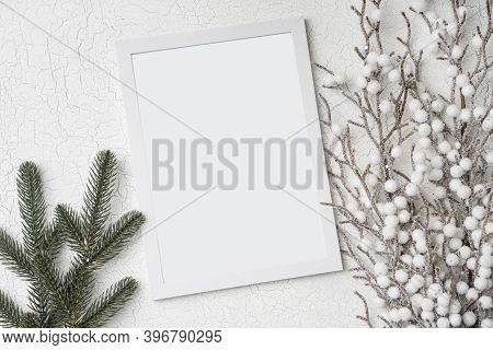 Christmas Winter Flatlay With Empty Wooden Frame, Fir Tree Branch And Frozen Bush. Top View Backgrou