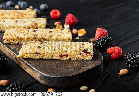 Superfood Breakfast Bars With Oats Nuts And Berries With Copy Space, On Black Wooden Table