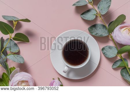 A Small White Coffee Mug On A White Saucer. Espresso. Flatlay. The View From The Top. Soft Pink Back