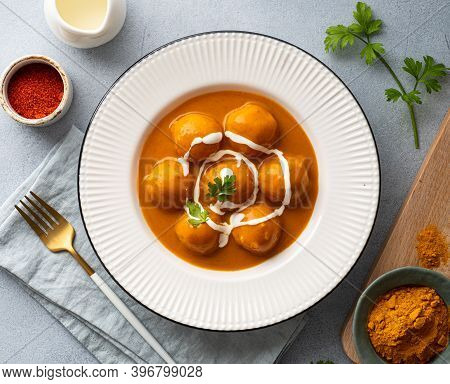 Malai Kofta Curry In A White Plate, Indian Cuisine, View From Above