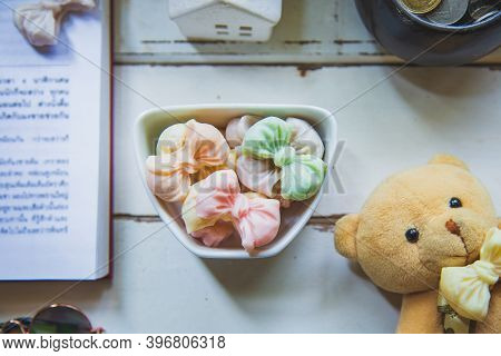 Top Views Allure Thai Candy In A Mini Bowl On A Rustic Wooden Table With An Open Book, Allure Is Tra