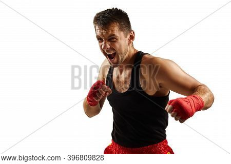 Sporty Man In Red Sports Bandages On His Hands Fighting Isolated On White Background