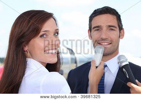 Man talking to journalists