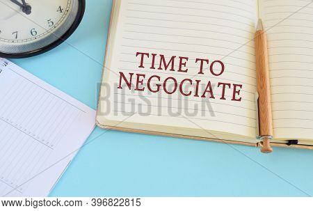 Notebook With Text Time To Negotiate On Bright Blue Background.conceptual Photo The Seller Accepts O