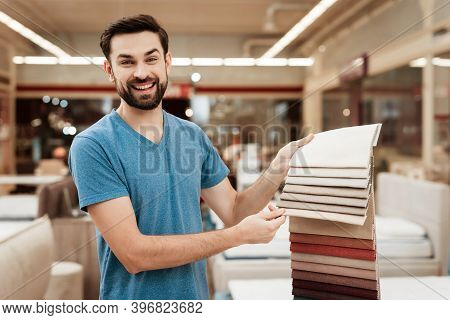 Satisfied Bearded Man Choose Color On Color Palette. Selecting Color Of Mattress On Color Palette Gu