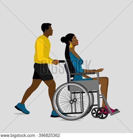 Volunteer Man Walking With Girl Disabled In Wheelchair. Disability Rehabilitation, Invalid People As
