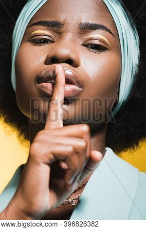 African American Woman In Blue Stylish Outfit Showing Shh Isolated On Yellow
