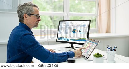 Analyst Employee Using Spreadsheet Software On Computer Screen