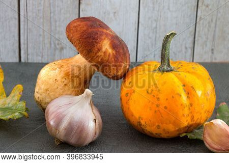 Pumpkin, Cep Boletus And Fall Leaves, Autumn Background, Crope View