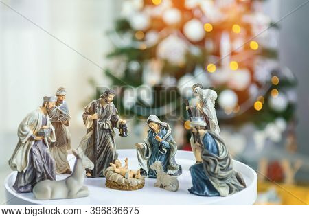 Christmas Manger Scene With Figurines Including Jesus, Mary, Joseph, Sheep And Wise Men. Focus On Mo