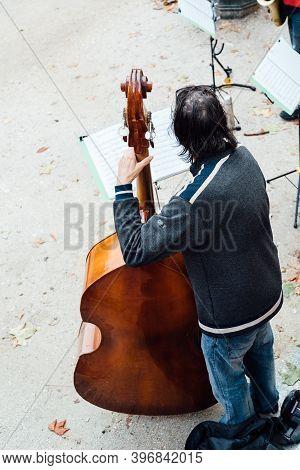 Madrid, Spain - October 24, 2020: Classical Street Music Quartet Playing In Buen Retiro Park During