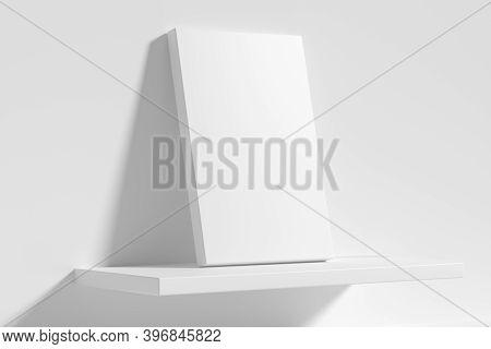 Blank White Empty Rectangular Poster On White Shelf Leaning At Empty White Wall, Diagonal View, Whit