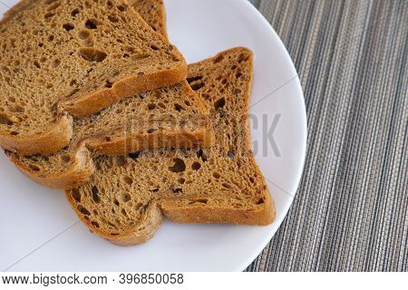 Slices Of Whole Grain Gluten Free Bread On A Plate. Close Up.