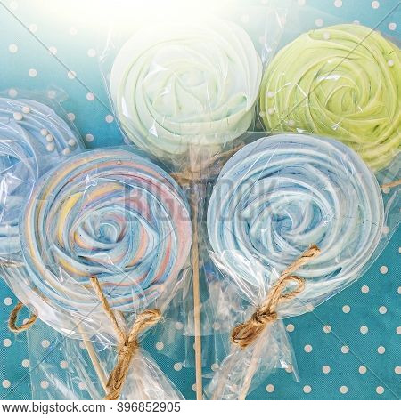 Sweets Set: Hand Made Multicolored Meringue On Wooden Stick On White Background. Concept Of Sweets F