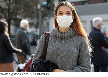 Portrait Of Young Student Woman Walking In City Street Wearing Surgical Mask. Girl With Face Mask Wa
