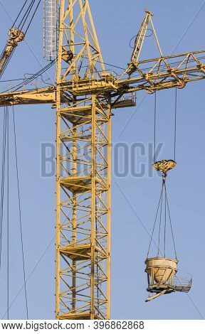 Construction Site With Crane On Blue Sky Background. Big Machinery Construction Crane Tool Of Buildi