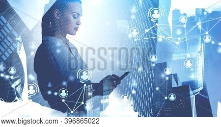 Side View Of Serious Young Businesswoman Using Smartphone In Blurry City With Double Exposure Of Hr