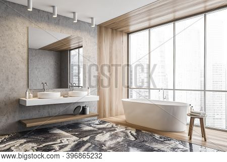 Corner Of Modern Bathroom With Concrete And Wooden Walls, Marble Floor, Comfortable Bathtub And Two