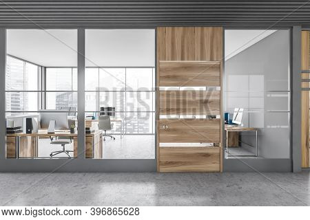Interior Of Modern Office Hall With Gray And Wooden Walls, Concrete Floor And Open Space Office. 3d