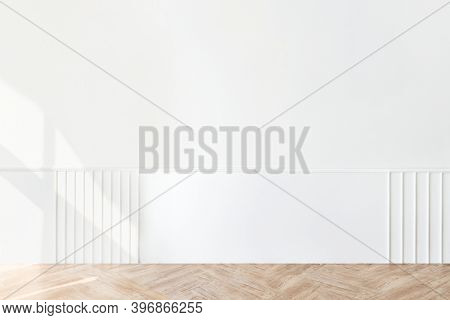 Plain white wall with a parquet floor