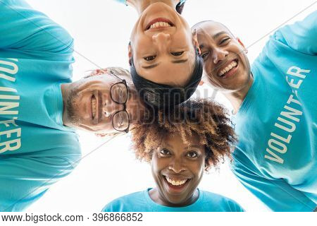 Group of happy and diverse volunteers