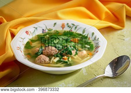 Italian Wedding Soup. Soup With Meatballs And Vegetables. Vegetable Soup With Chicken And Beans. Sid