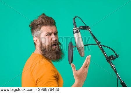 Studio Records. Man Sing In Microphone. Karaoke. Man Singing With Microphone. Singing In Studio. Mic
