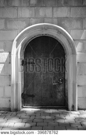 Modern White Brick Stone Wall With Closed Black Wooden Door, Horizontal Stock Photo Image Background