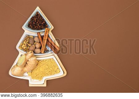Cloves, Cinnamon, Nutmeg, Cardamom And Ginger For Making Ginger Cookies In A Box In The Shape Of A C