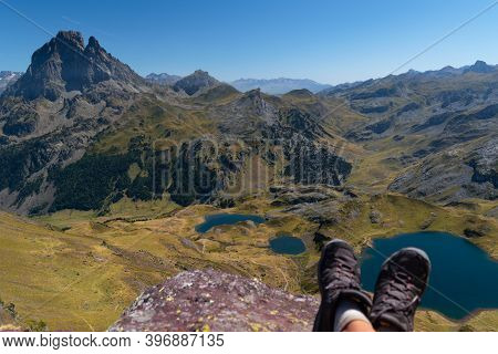 Out Of Focus Boots Of A Hiker Atop Ayous Peak Overlooking Ayous Mountain Lake And The Pyrenees Mount