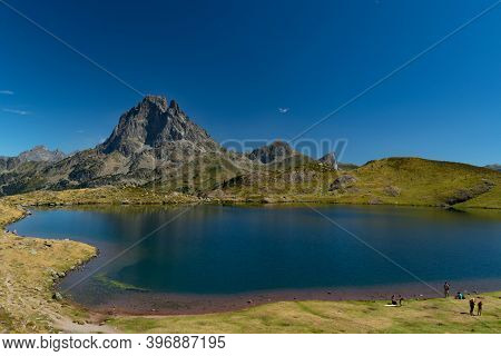 Bathers' Pools On The Shores Of Ayous Mountain Lake With The Mountains And The Top Of Midi D'ossau I