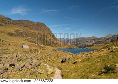 Mountain Trail That Leads To The Ayous Refuge With The Mountain Lake Of The Same Name Surrounded By