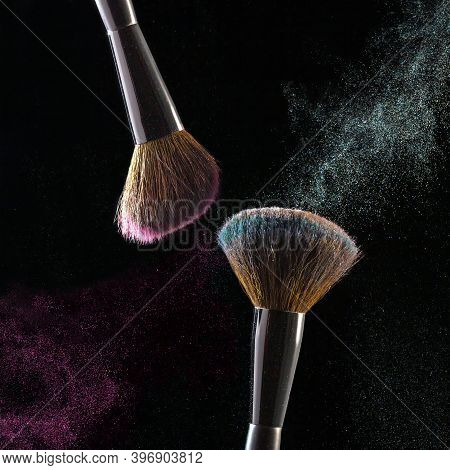 Makeup Brushes, Powder Particles Dynamically In The Air. Spray Cosmetics. Frozen Dust, Space Simulat