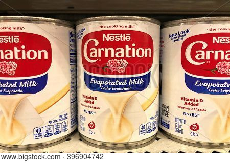 Oakland, Ca - Nov 10, 2020: Grocery Store Shelf With Cans Of Nestle Carnation Brand Sweetened Conden
