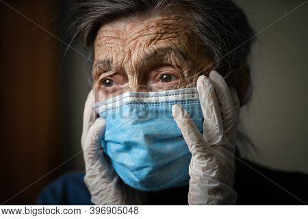 Portrait Senior Woman Holding Head Hands, Sad Worried Emotion In Protective Medical Mask, Gloves Aga