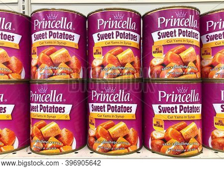 Alameda, Ca - Nov 16, 2020: Grocery Store Shelf With Cans Of Princella Brand Sweet Potatoes. Cut Yam