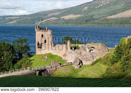 Drumnadrochit, Scotland - August 8, 2019: Urquhart Castle At Nice Sunset With A Shadow Near Drumnadr