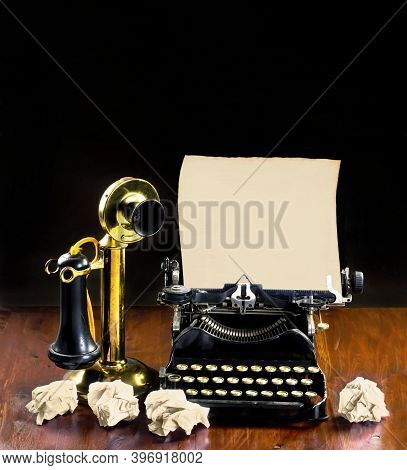 Antique Typewriter And Old Brass Stick Telephone With Room For Your Type.