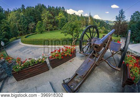 Sinaia, Romania - July 21, 2020: Decorative Military Cannon From 18th Century In Peles Castle Area,