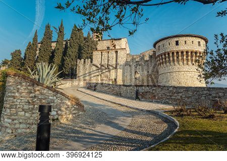 The Castle Of The City Of Brescia On A Sunny Clear Day Against A Bright Blue Sky. Part Of Brescia Ca