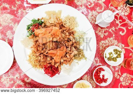 Yusheng Or Yee Sang Is Traditional Customary Food Consumed During Chinese New Year For Luck And Pros