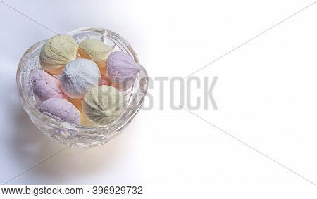 Small Homemade Meringue Kisses. Banner With Meringue Cookies In Glass Bowl Isolated On White Backgro