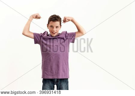 Teenaged Disabled Boy With Cerebral Palsy Smiling At Camera And Raising Clenched Fists, Feeling Stro