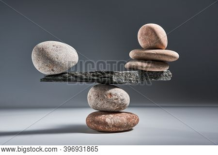 Balancing Pyramid Of Sea Pebbles On A Gray Background, The Concept Of Harmony And Balance, Heavy And