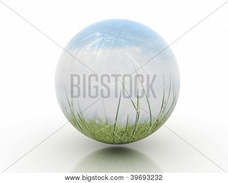 Glassy orb with green nature and blue sky