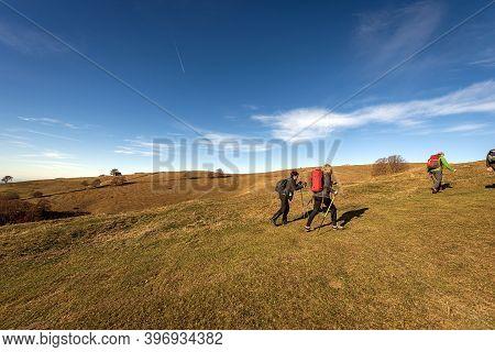 Altopiano Della Lessinia, Italy - Nov 22, 2020: Small Group Of Adults Hiking On The Lessinia Plateau