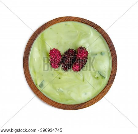 Yoghurt Mix Green Tea Flavor Powder With Nata De Coco Dutchie And Mulberries Fruit In Wooden Bowl Is