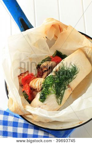 Butterfish fillet baked with mushrooms  and vegetables