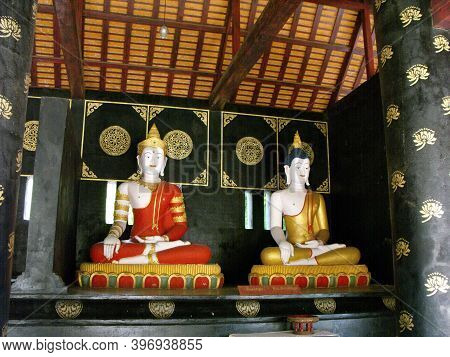 Chiang Mai, Thailand, April 25, 2016: Two Elegantly Dressed Buddhas Next To The Wat Chedi Luang Stup