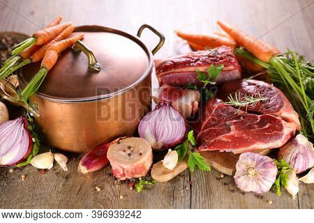 casserole,  raw beef and fresh vegetables- cooking beef soup, beef stew,  pot au feu